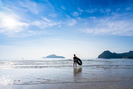Asian kid boy playing the sea at Ao Manao, Prachuap Khiri Khan, Thailand