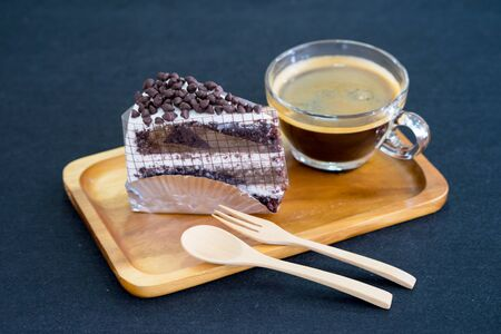cake chocolate on wooden plate