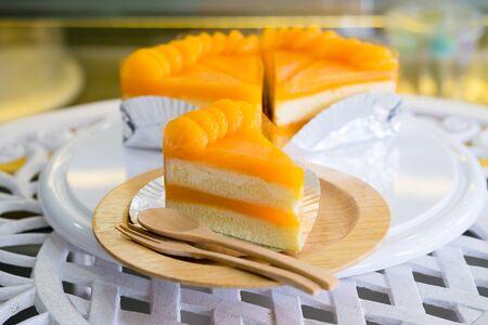 Orange Cake on wooden plate