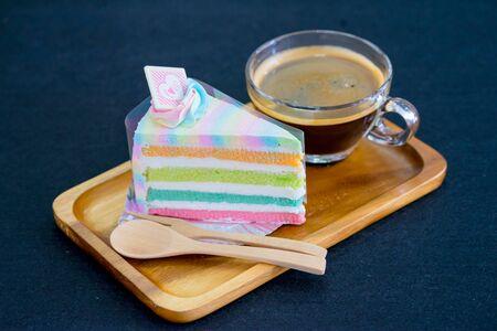 rainbow cake on wooden plate