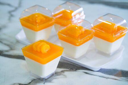 orange panna cotta on  table Stockfoto