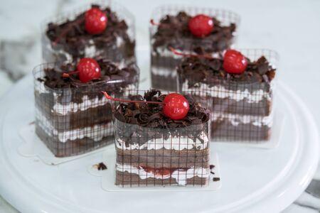Black Forest, Chocolate cake on white dish Stockfoto