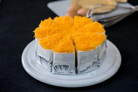 Gold Egg Yolk Thread Cakes on wooden plate