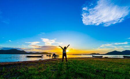Happy Child boy with sunset at Bang Phra Reservoir, Bang Phra, Si Racha District, Chon Bur