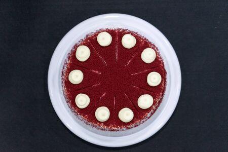 Red Velvet Cheesecake on black background