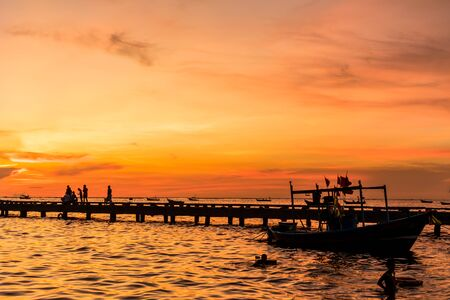 Silhouette of Harbor bridge and people during sunset at Bang Phra Beach,sriracha choburi,thailand Imagens