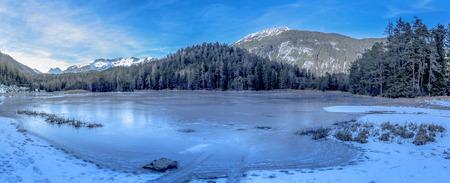 frozen lake: Alpine frozen lake - Winter landscape with a frozen lake and the Austrian Alps in background. Image taken near the village Biberwier, from the district Reutte, Austria. Stock Photo