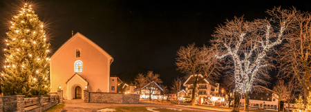 austrian village: Winter night lights in an Austrian village - Night photography in the Ehrwald village, from Austria, during winter season, when all the buildings and trees are decorated with lights.