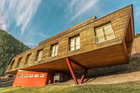 strange mountain: Modern house architecture - Architectural image with a house clad with planks and in the same time having a modern design.