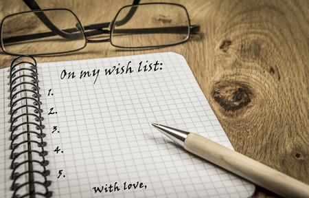wish  list: Wish list on spiral notebook - Small agenda notebook with a wish list written on its page in vintage settings