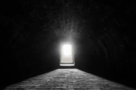 German medieval basement - Interior image with a medieval german wine cellar, with its stone floor and the sunlight at the entrance Stock Photo