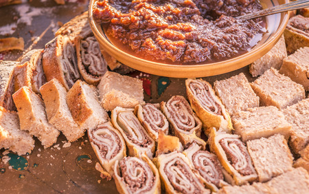 specific: Sweet rolls and tasty cakes based on dried pears, served with a delicious pear jam, specific to the Zasip town, Slovenia. Stock Photo