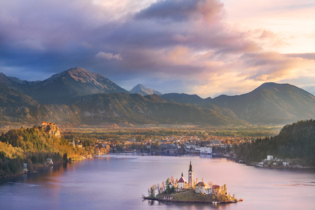 Colorful sunrise over the Bled lake, its surrounding hills, its island and the Karawanks mountains in the background, situated in Slovenia.