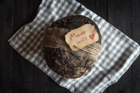 Home baked brown bread tied with a rope and a handwritten message
