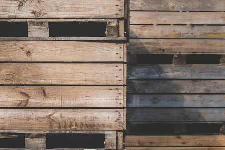 Storage wooden bins for the transportation of fruits and vegetables. Background of wooden crates. Warehouse with wooden crates close-up.