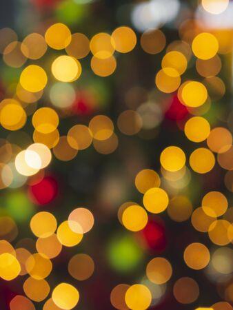 Christmas tree lights background. Xmas concept. Christmas traditions context. Defocused Christmas string lights. Bokeh lights backdrop. Reklamní fotografie