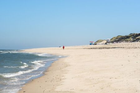 Beach scenery with fine sand and blue water, on sunny summer day, on Sylt island, at North Sea, Germany. Sandy beach and clear sky.  Summer vacation. 스톡 콘텐츠