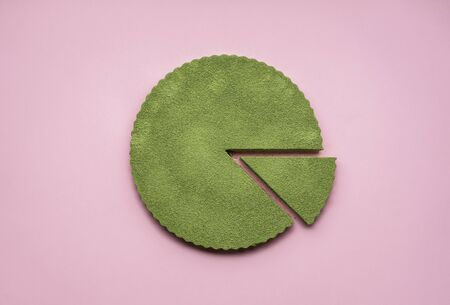 Green cheesecake made with matcha on vibrant pink background. One slice of matcha pie.