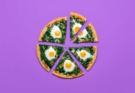 Slices of pizza with spinach, eggs and mozzarella, isolated on purple background. Sliced vegetarian pizza, flat lay. Tasty homemade florentine dish. Imagens