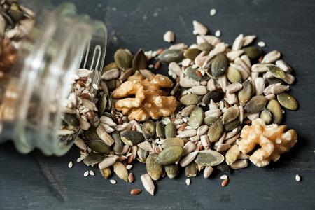seeds of various: various seeds, nuts, pumpkin seeds and varies in glass jar