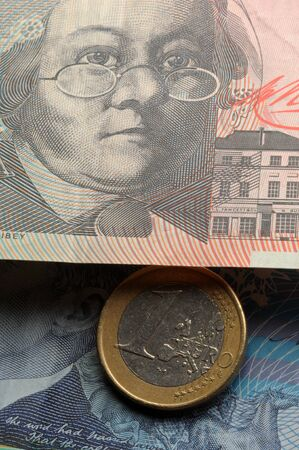 One euro coin on Australian banknotes Stock Photo