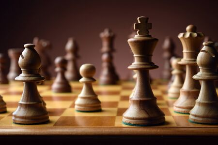 Chess on a wooden chessboard