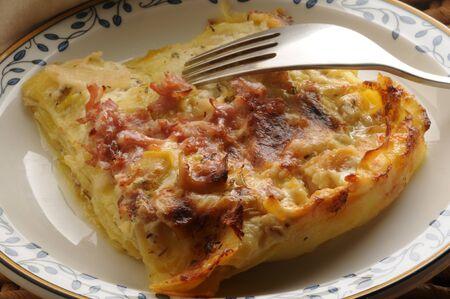 Lasagna with vegetables and raw ham Foto de archivo