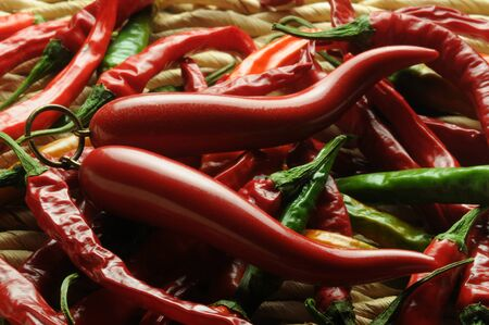 Italian horns on a pile of chillies Standard-Bild