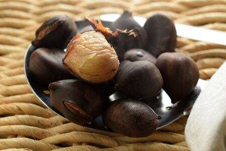 Close up of steaming boiled chestnuts