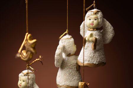 Hanging ceramic cherubs hanging from Christmas