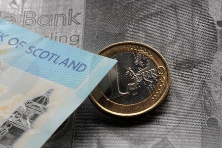Scottish pound with one euro coin Stock Photo