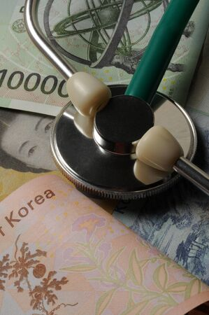 Stethoscope on various South Korean banknotes