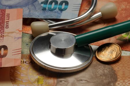 Stethoscope on South African banknotes and coins