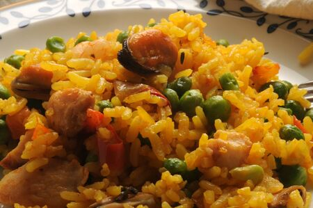 Spanish paella dish with fish and vegetables