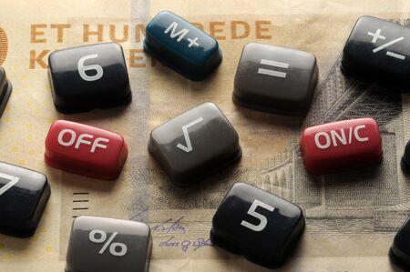 Calculator keys on denmark banknote