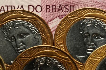 Closeup on brazilian banknote and coins