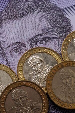 Closeup on coins and chilean banknote