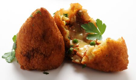 Open arancino, showing the rice and ragù stuffing