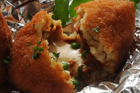 Open arancina, showing the rice and rag? stuffing