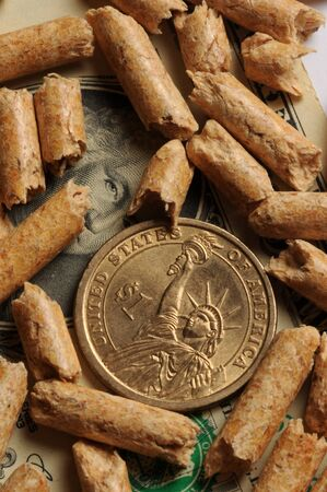 Close up on Us currency with wood pellets Stock Photo