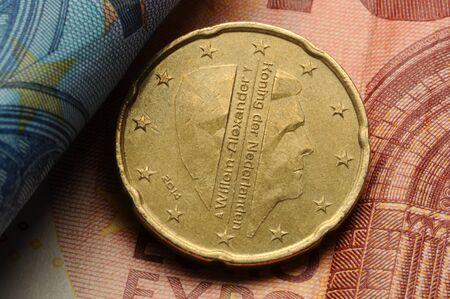 Dutch euro coin on banknotes