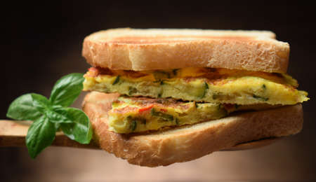 Slices of omelette with zucchini on a slice of bread Standard-Bild