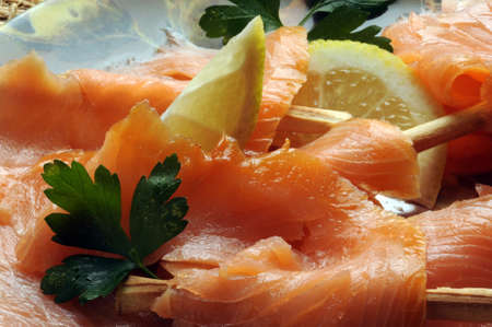 Plate of sliced salmon with breadsticks