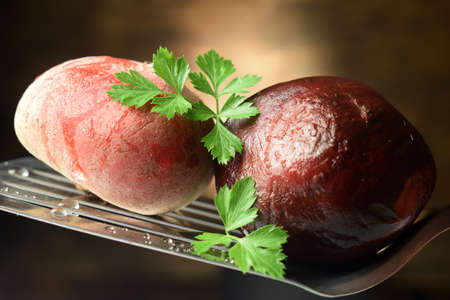 Close up on uncooked and precooked beetroot Standard-Bild