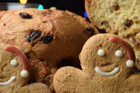 Close up on panettone and gingerbread men.