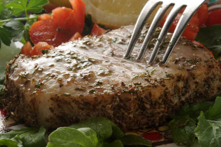Pork loin with herbs and vegetables