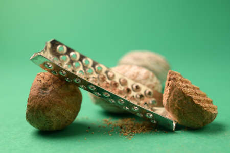 Closeup of nutmegs with grater