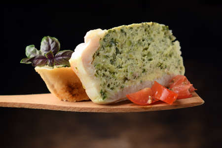 Fish flan with tomatoes and slice of bread Standard-Bild