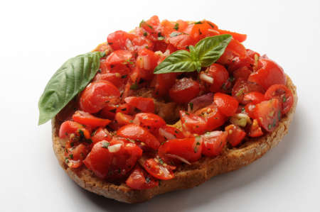 Closeup on frisella with tomato and garlic