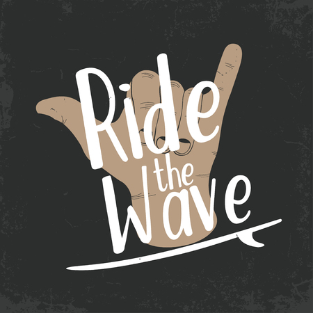Surfing typography for t shirt print. T-shirt graphics. Surfing shaka hand with lettering Ride the wave. Vector